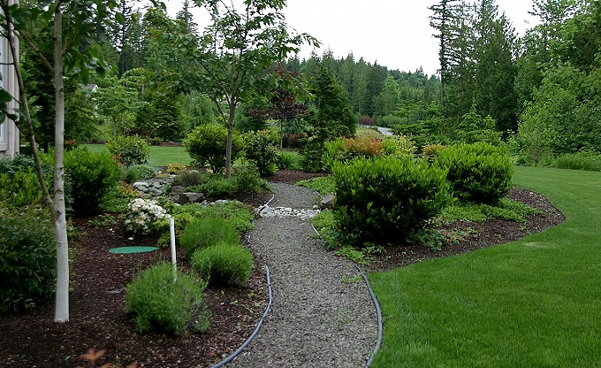Path and landscaping at side area.