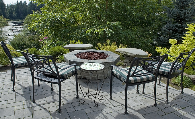 Patio seating area with gas firepit.