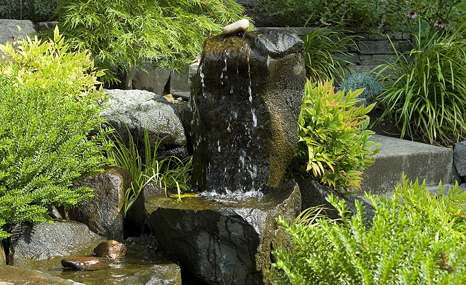 Small basalt column unit recirculating water feature.