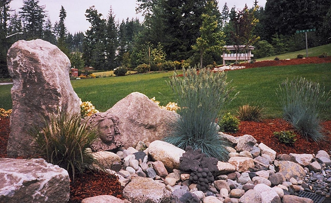 Sculptural accent with granite upright accent stone.