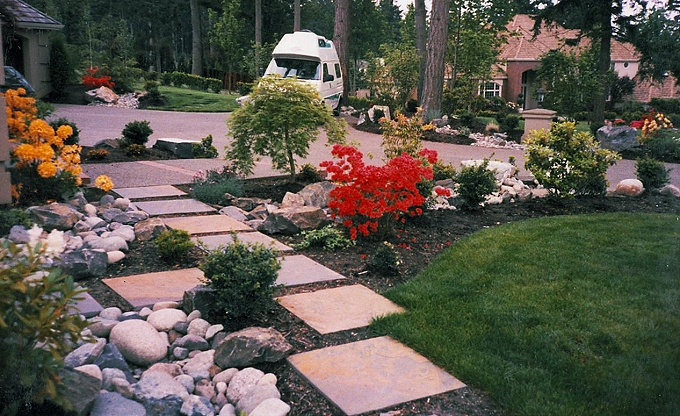 'Texada' precast paver walk with stone accents.