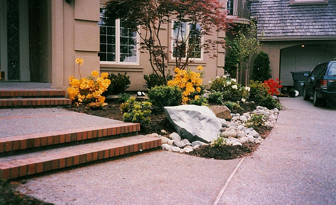 Entry accent boulders and mixed planting.