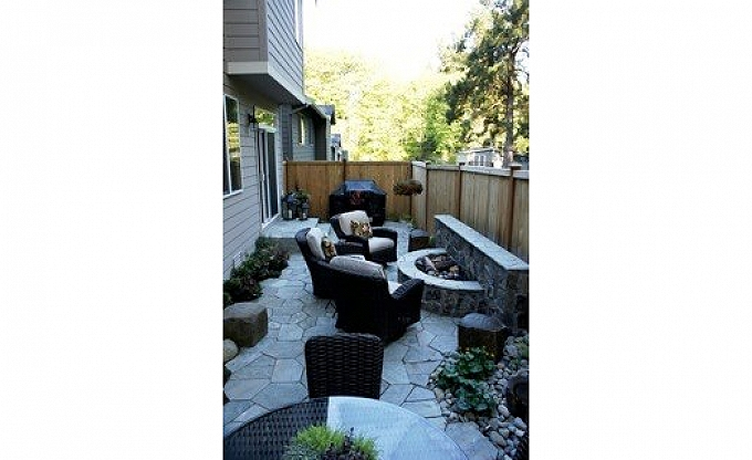 A narrow backyard area