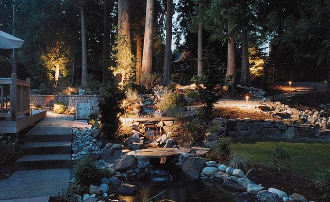 The original Discolo residence, it's low voltage lighting featured in a magazine with the new waterfall pond on display. We not only did the Discolo's next home after they moved, but returned here in