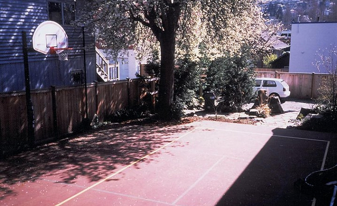Seattle's premier grunge rock band's recording studio gets a nifty pickleball court. The big gnarly pear tree in the corner was almost a casualty in trying to make the court regulation sized. Seeing a