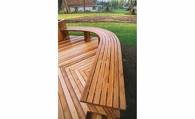 This deck detail was done about 25 years ago by a subcontract carpenter from our design. This is clear cedar deck with a bent laminate bench.