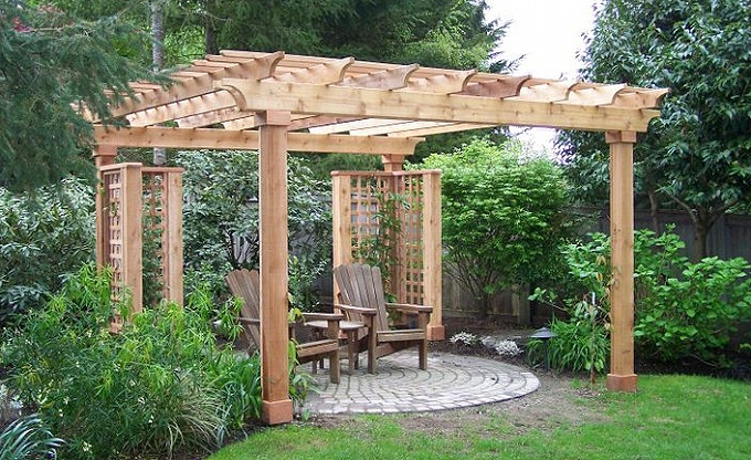 Large clad posted arbored patio with heavy rack detail on arbor.