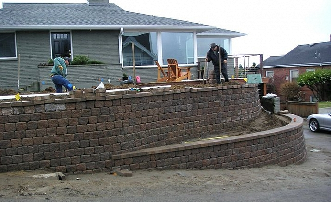 'During' image of the problematic slope, fixed in short order with a 'Roman pisa' type modular wall and raised planter.