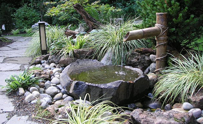 Simple boar scare into a dishbowl. We construct a lot of these simple water features as well as large ponds, waterfalls and streams. Mercer Island.
