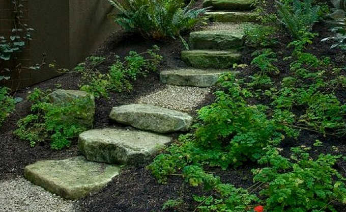 Natural ledge stone steps and risers with intermittent landing areas make a comfortable and cost-effective, natural transition between garden areas.