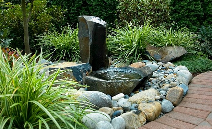 Simple three rock water feature with column and dish stone.