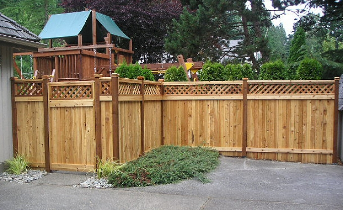 Estate style fence with lattice top.