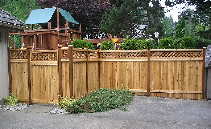Play area at rear with estate style fence with lattice top.