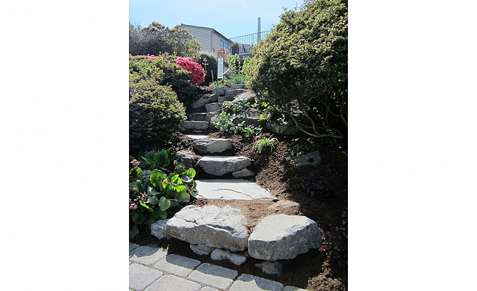 These are somewhat typical basalt steps, in this case, serpentine with bluestone slate to match the the homes existing slate. Little Magnolia project 2012.