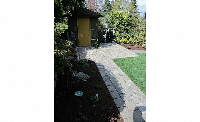 New Roman Dominion paver walkway with potting shed landing area. Little Magnolia project 2012.