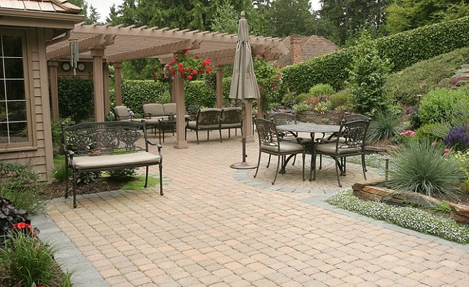 Custom painted heavy arbor over patio and ledgestone wall with sand set patio. Trepanier residence, Hunters Glen, Redmond.