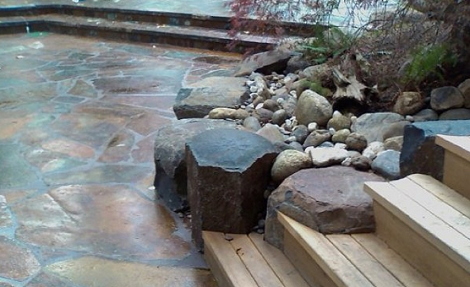 Underwood residence. Bridle trails area Bellevue. Columbia gorge granite split and fitted to the deck steps. Tony Villa, Classic foreman.