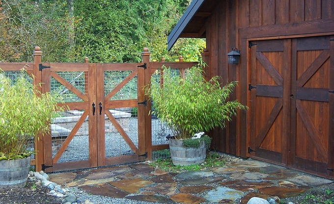 Heavy frame galvanized mesh garden fence and gate to complement the building style.
