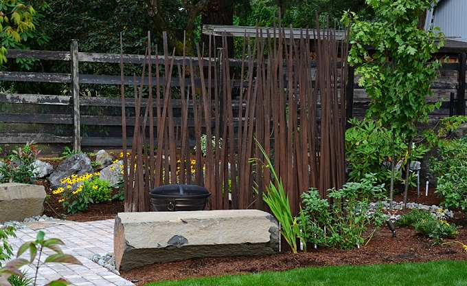 Not galvanized, but a Corten steel grasswall with Columbia column benches. Baucis & Philemon garden.