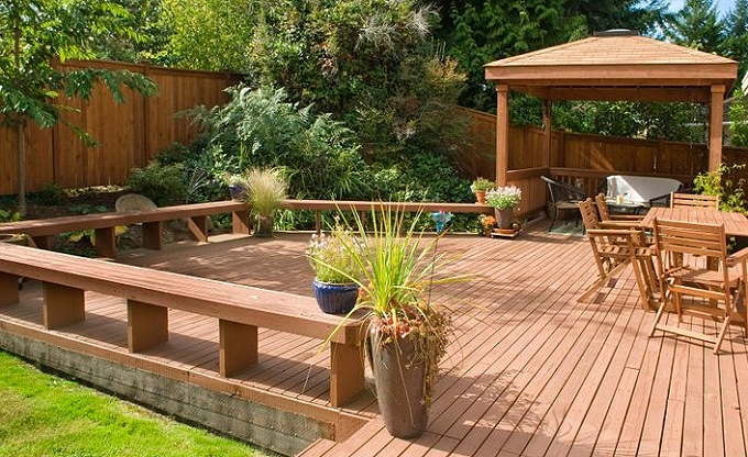 Deck construction with raised seat areas and outdoor room by CNLC.