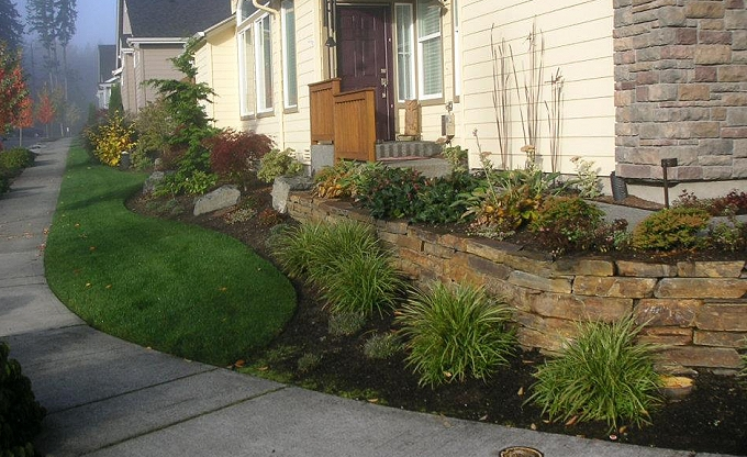 AFTER: New ledgestone wall adds visual interest and room for new plants. Curb appeal is year round now. � at Trilogy 55 Plus.