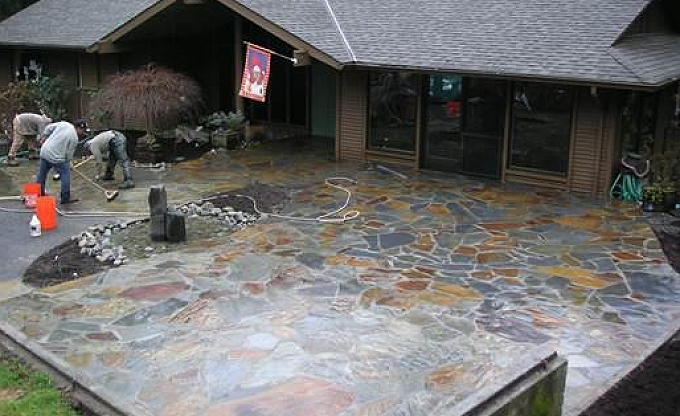 Bernard after ....a mortared flagstone patio and raised retaining seatwall.