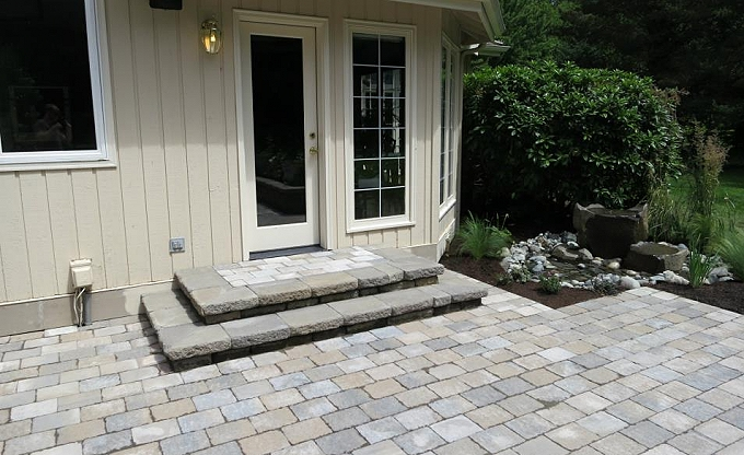 After: we built a small patio and rear step renovation and basalt dishbowl water feature by Sam Millar, esq.