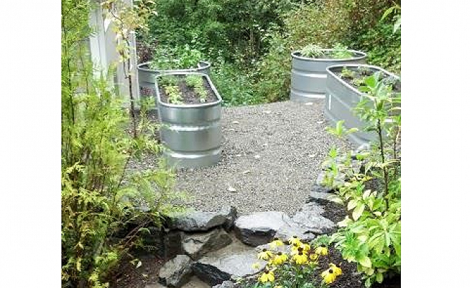 The upper garden area (after): With steps and inexpensive compacted crushed rock base. This can receive flagstone or tumbled pavers later, but is often a good 'first phase' material, as the savings bo