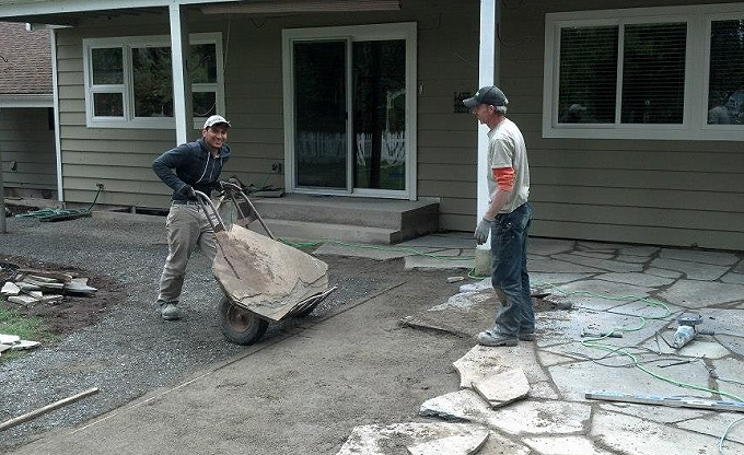 Here we are moving in very large pieces of Variegated Pennsylvania Bluestone. �¢ï¿½ï¿½ at Site progress at the Filoteo residence in Woodinville.