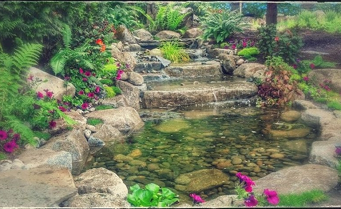 We also built this waterfall & pond in Medina.