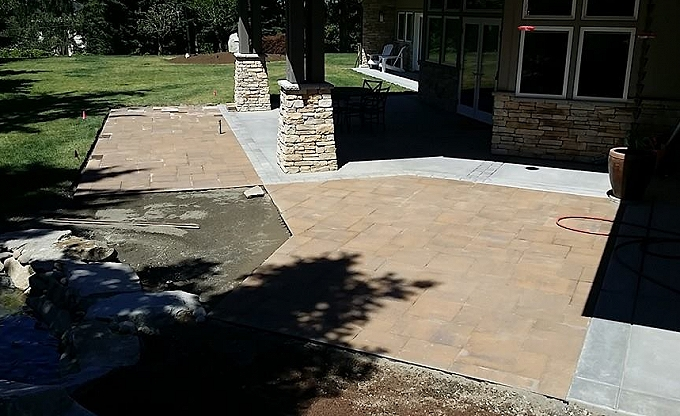 Starting a patio of Belgard 'Lafitt rustic slab' in Bellevue...
